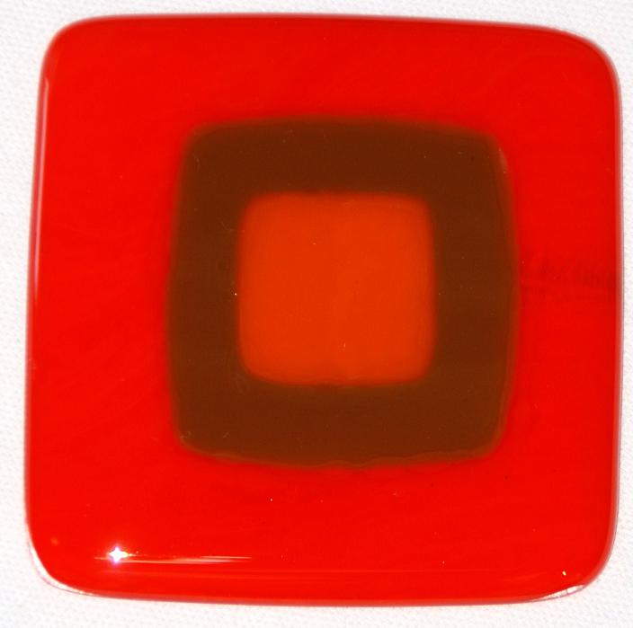 Craftsman fused glass tiles in pimiento, woodland brown, and tangerine