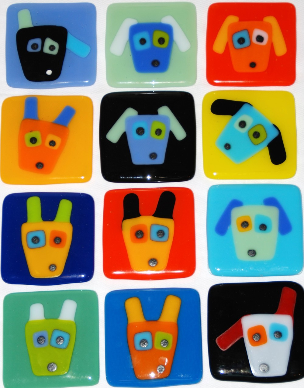 12 dog coasters in fused glass.JPG