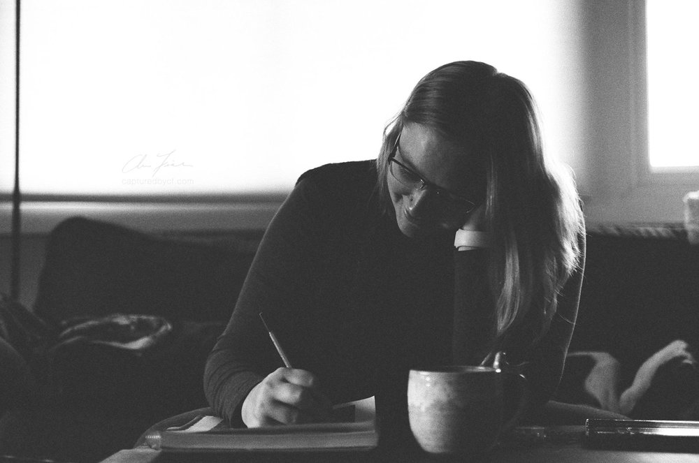 chris-fisher-photography-kalamazoo-mi-woman-writing-indoors-kodak-tri-x-pushed-nikon-2016.jpg
