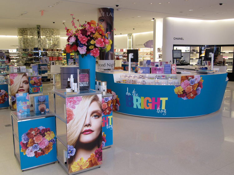 Store Interior showing cash wrap, Merchandising Cubes, Acrylic Sign & Decor