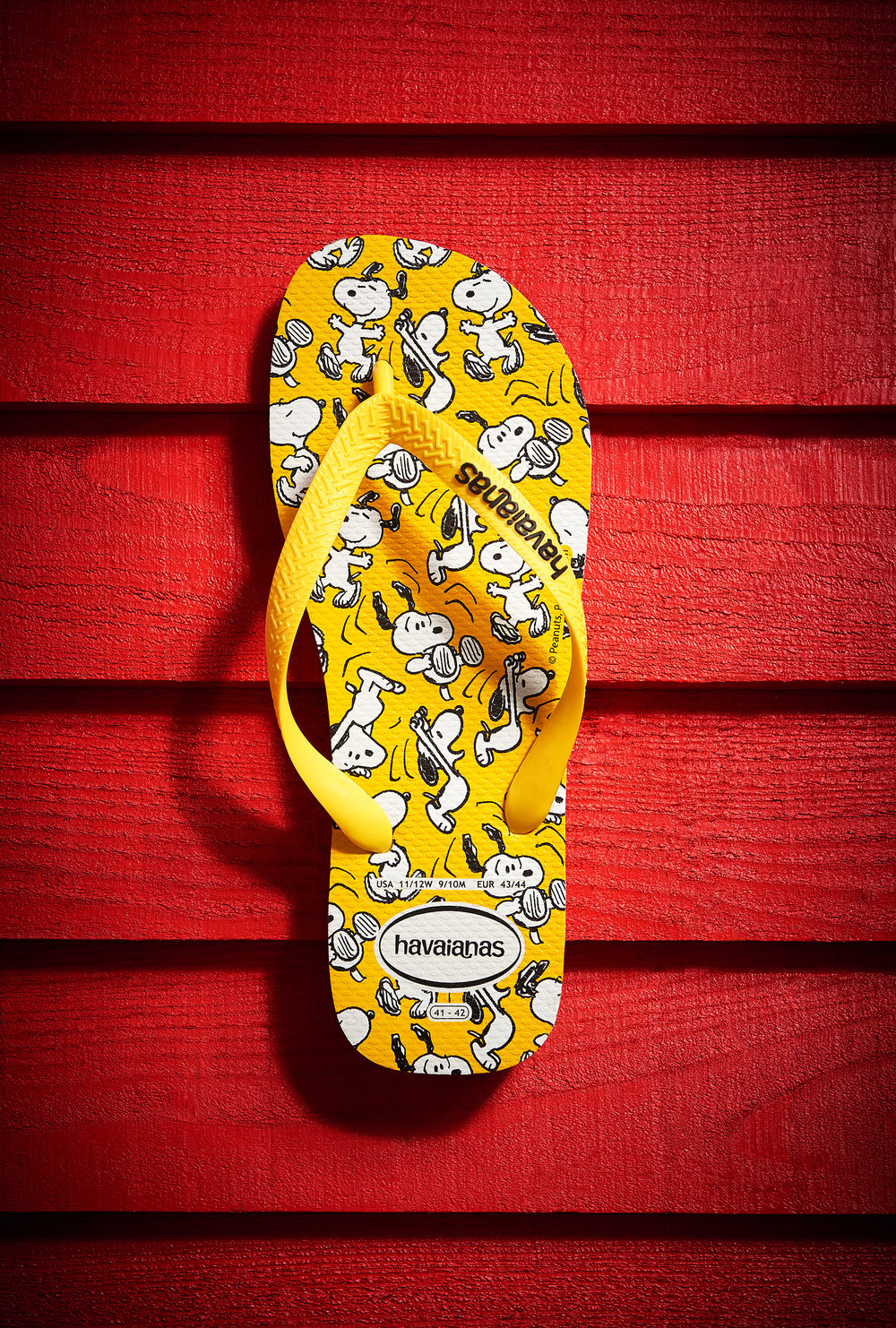 Product still life image for a Havaianas, a footwear company featuring Snoopy and the Peanuts gang