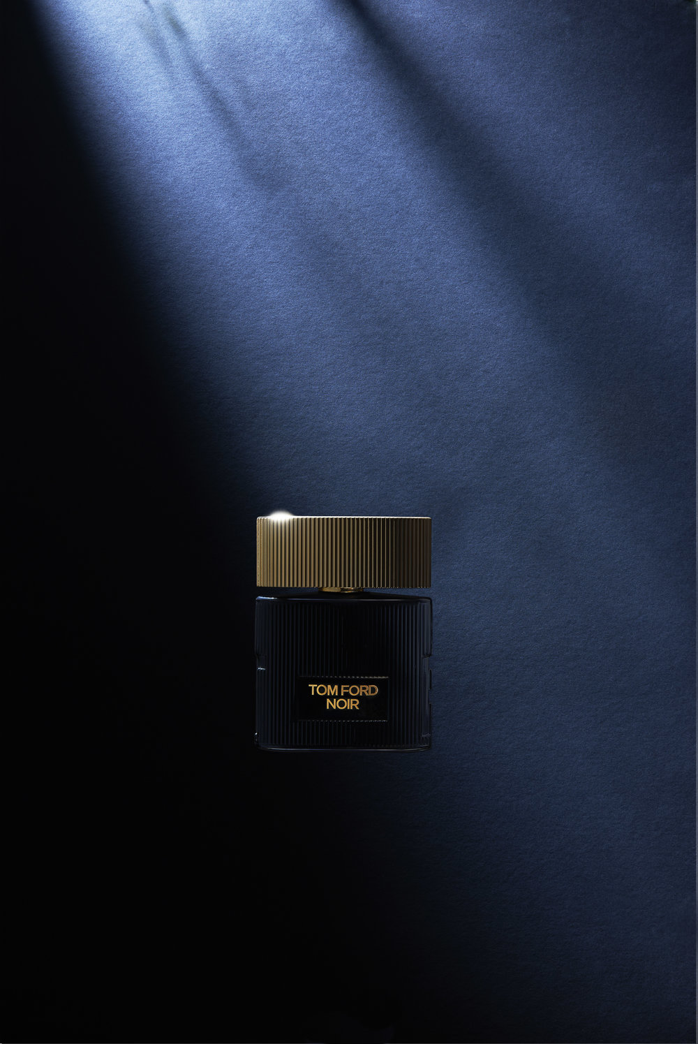 Still life product photography of a perfume bottle for Tom Ford Noir. Photographed in the moonlight