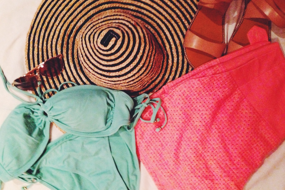 Packing the goods! My favorite teal suit, bright orange high waisted shorts, aviators, and of course  the big floppy hat!