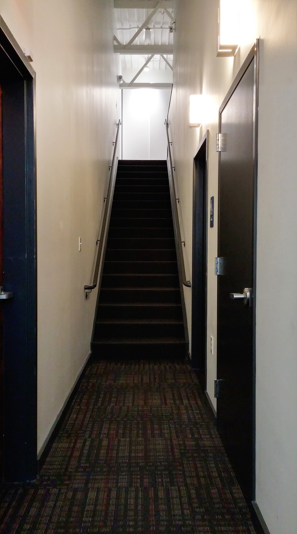 Utility corridor and access stair to Mezzanine above