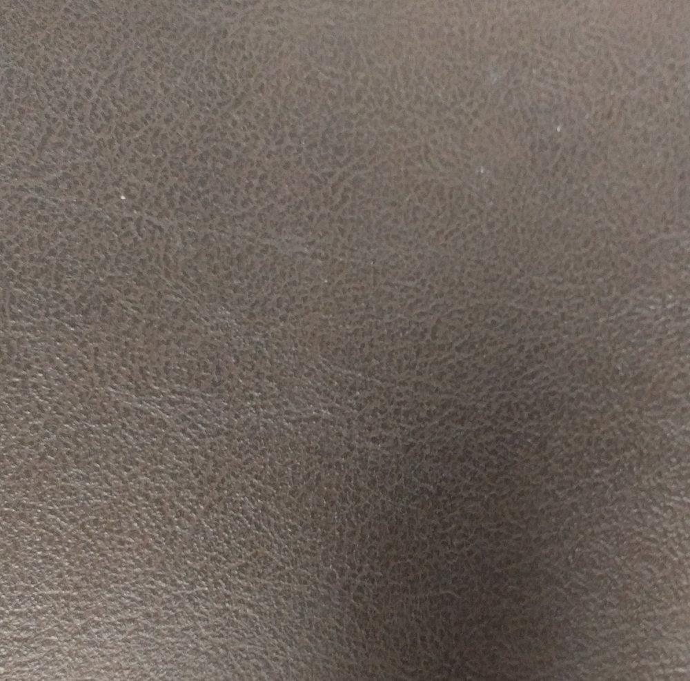 Hardwood Flooring Company: Milano Hide Leather Himalayan Goat behind TV in Master Bedroom Built-in