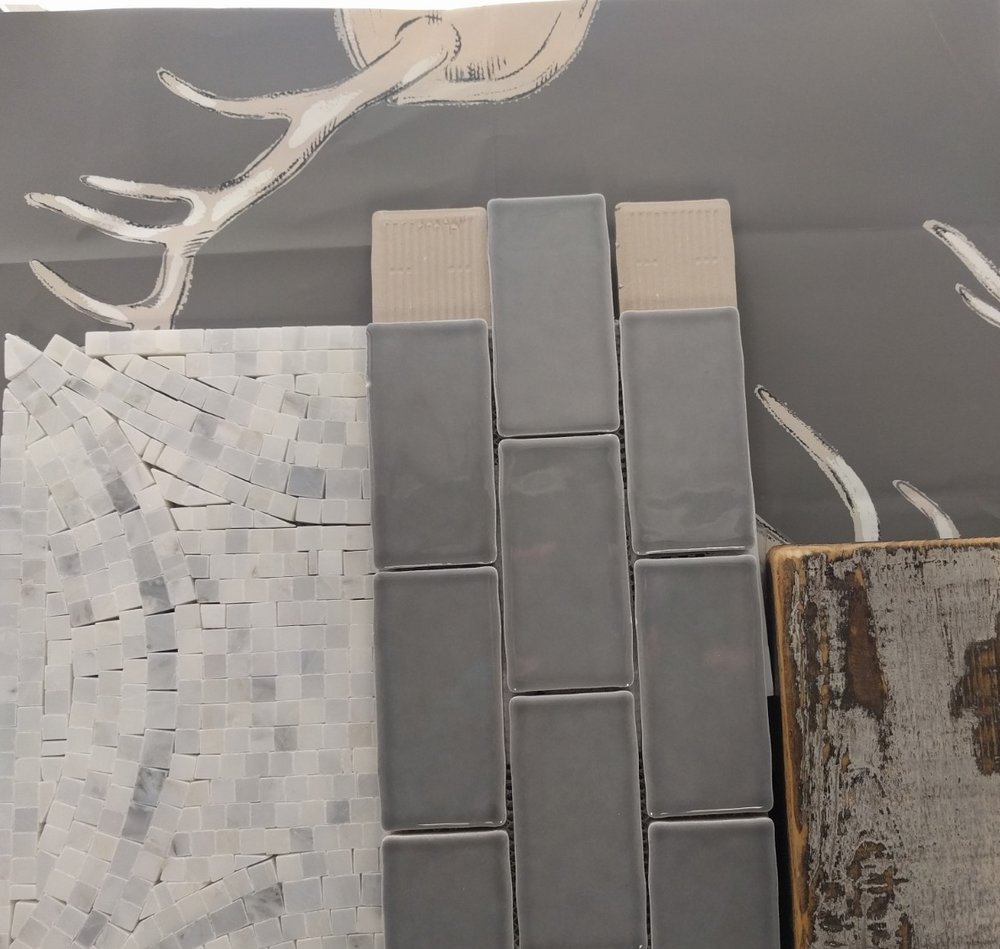 Wall covering:  Kravet/Lee Jofa Antlers Paper Grey P2017102-11   Field Tile:  Floor & Decor Avillano Soho Deco White Polished Marble Mosaic Size: 12 x 12 SKU: 931100226   Border Tile:  Floor & Decor Canvas Slate Gray Ceramic Tile            Size: 3 x 12 SKU: 100253483   Cabinet Finish:  Misty Grey