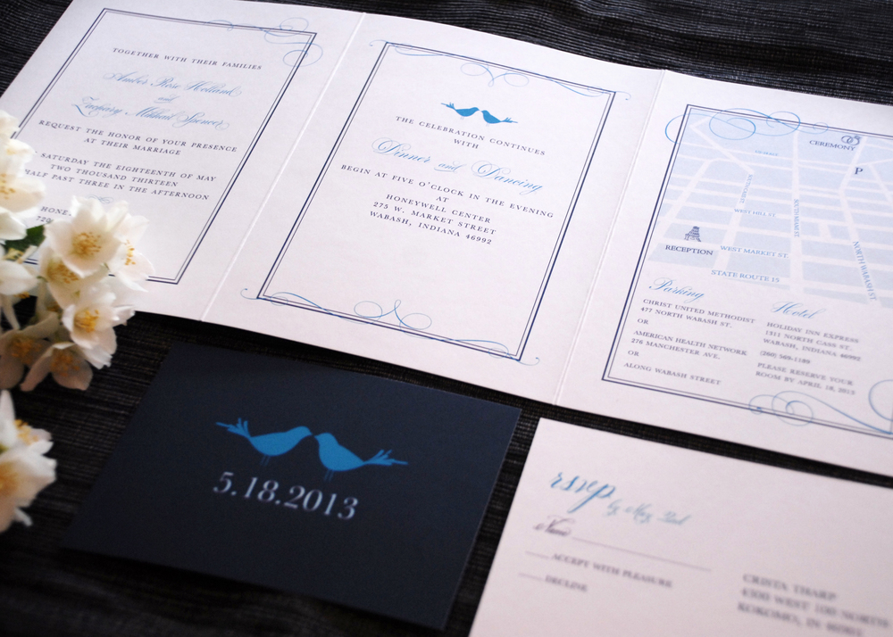 Tri-fold wedding invitation with RSVP postcard. Panels include: wedding invitation, reception invitation and informational map along with hotel and parking details via Studio255