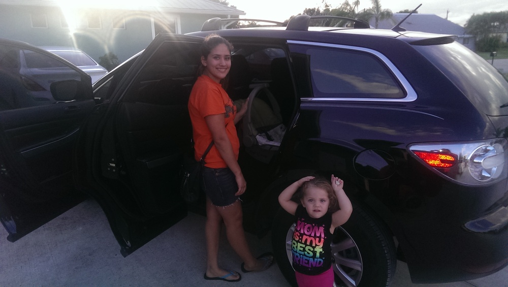 Resident posing with her daughter as they head out in the SUV purchased by SWP 12/2014