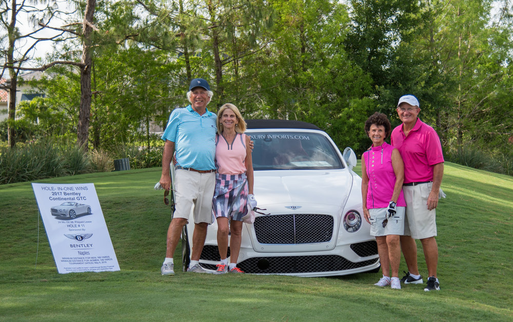 Jack and Fran Brozman, Jackie and Angie Rossi with the Bentley Hole in One Prize