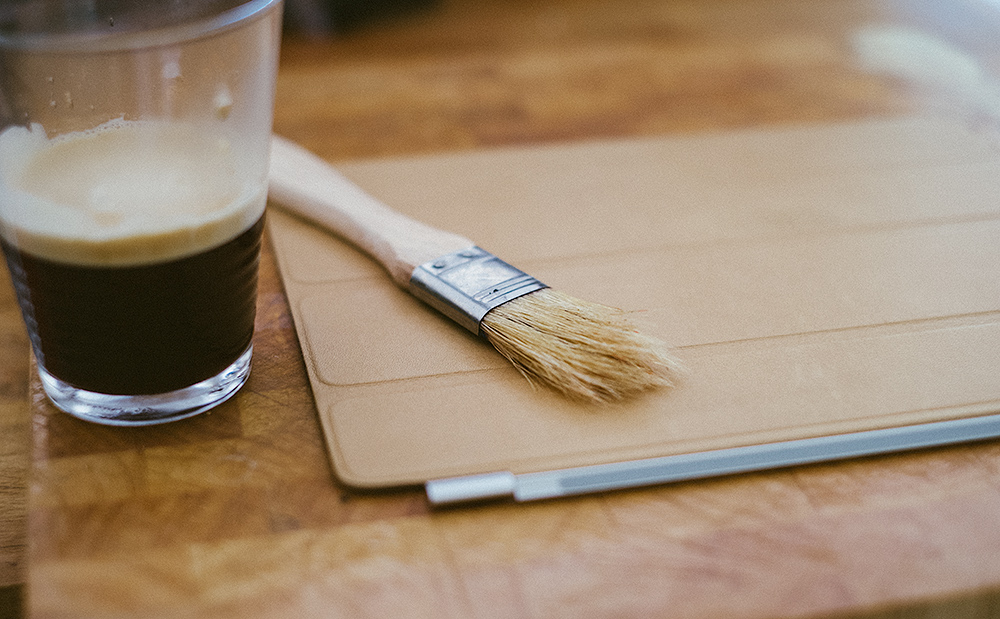 Espresso, leather, and a brush.