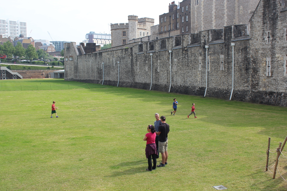 Children playing on the moat