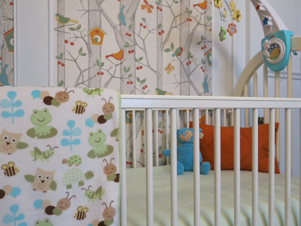 In this nursery, we applied the wallpaper on the inside part of the 1920's original moldings