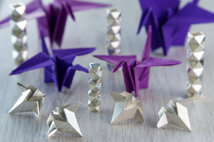 Earrings and necklace design based on paper folds, with paper cranes in the background.