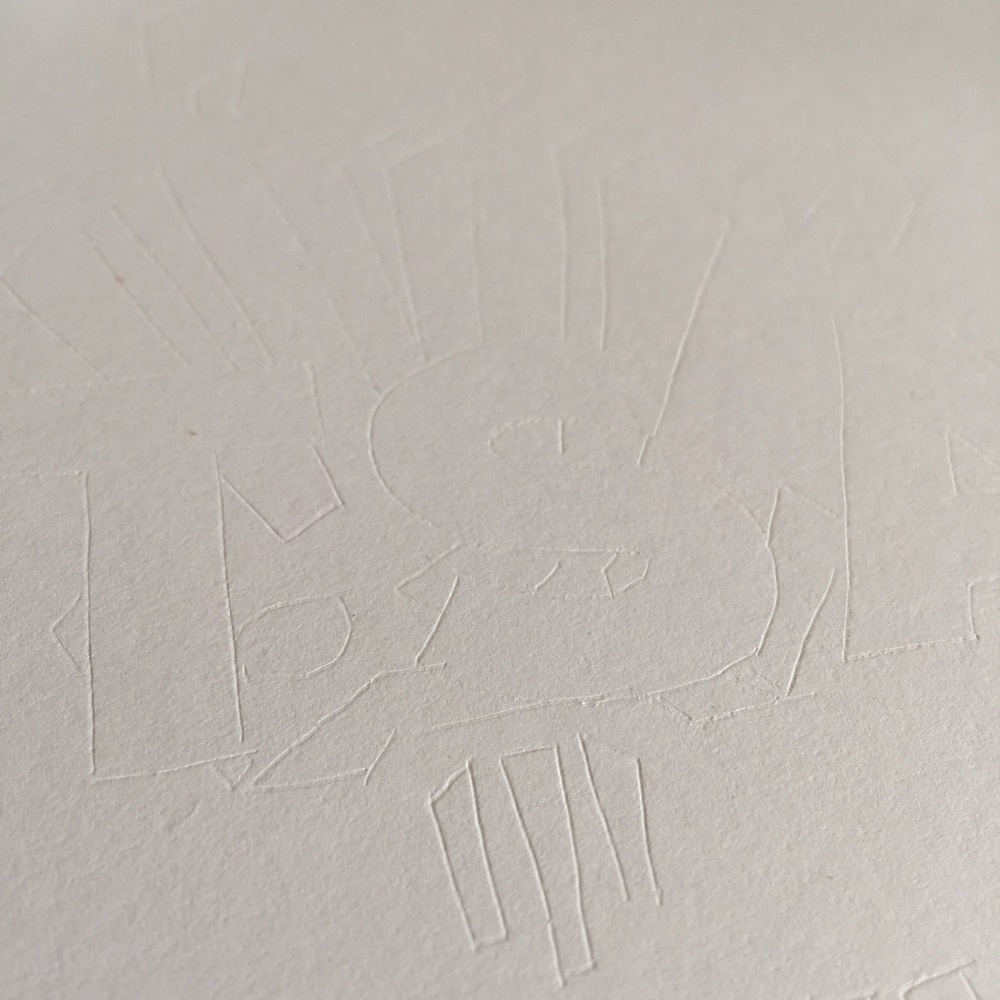 Tracing the outline to create the indentation on the card