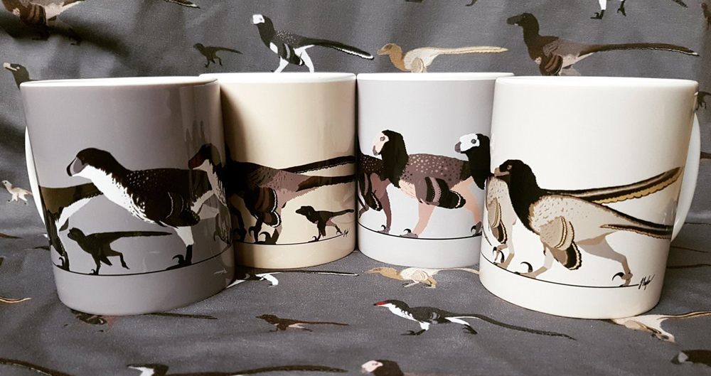 An amazing display of merchandise will be on sale at TetZooCon this year, be sure to bring £££. These dromaeosaur-themed mugs will be there, and are by the inimitable Jed Taylor, what a star. Image: Jed Taylor.