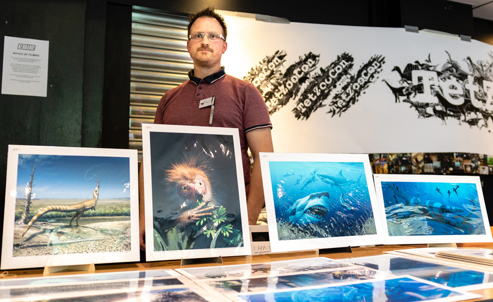 Bob Nicholls of Palaeocreations was selling prints, including those featuring the cover and concept art for Naish & Barrett's  Dinosaurs: How They Lived and Evolved . Image: Xane/Michael Lesniowski.
