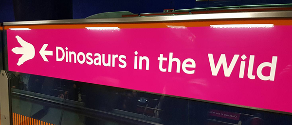A sign that will greet you as you leave North Greenwich underground station, London. I'll write, at length, about   Dinosaurs in the Wild   sometime soon.... [UPDATE: I eventually published both   Dinosaurs in the Wild: An Inside View   at ver 3 and   The Last Day of Dinosaurs in the Wild   here at ver 4]. Image: Darren Naish.