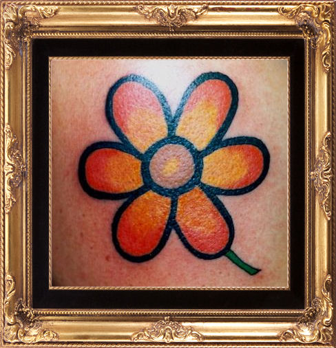 Peggi hurley flower tattoo.jpg