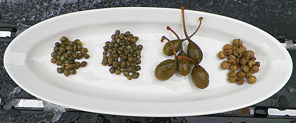 Four different capers from the pantry.
