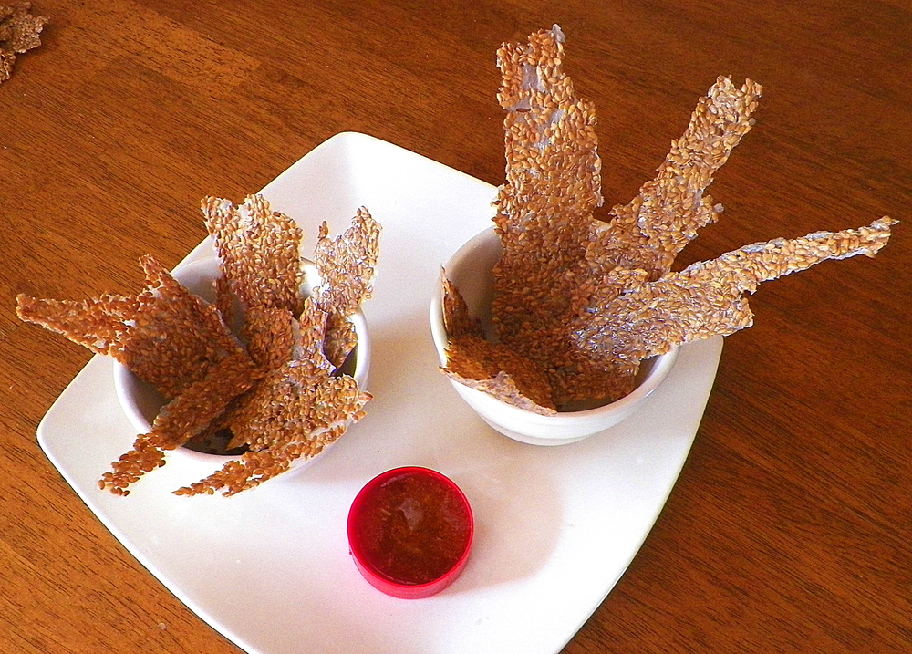 Linseed or Flax Seed Crisps with hot honey sauce.
