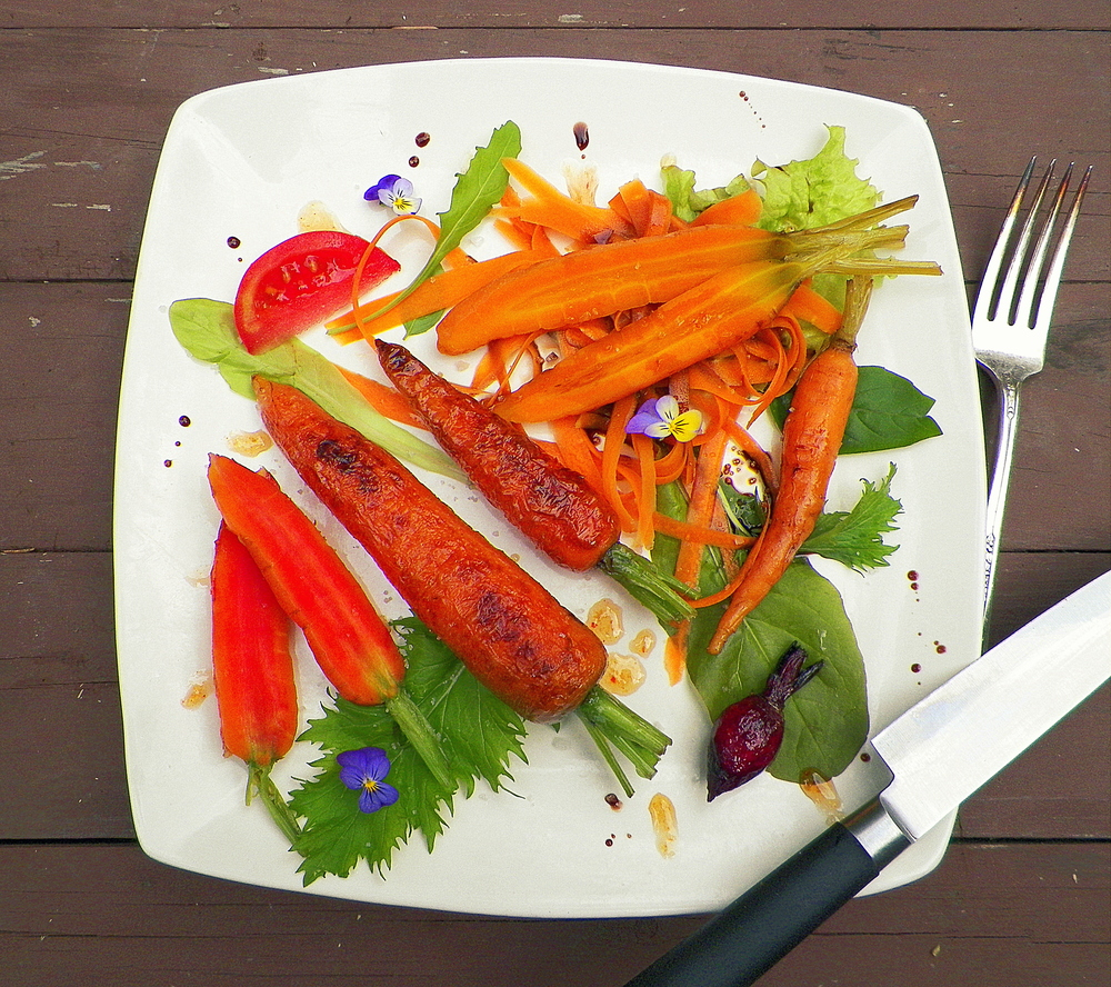 Carrot medley - carrot slaw with maple balsamic, pickled carrots, blanched and fried carrots with bourbon honey sauce.