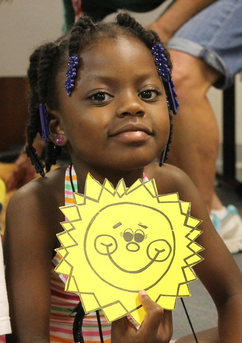 Girl holding sunshine cropped.jpg