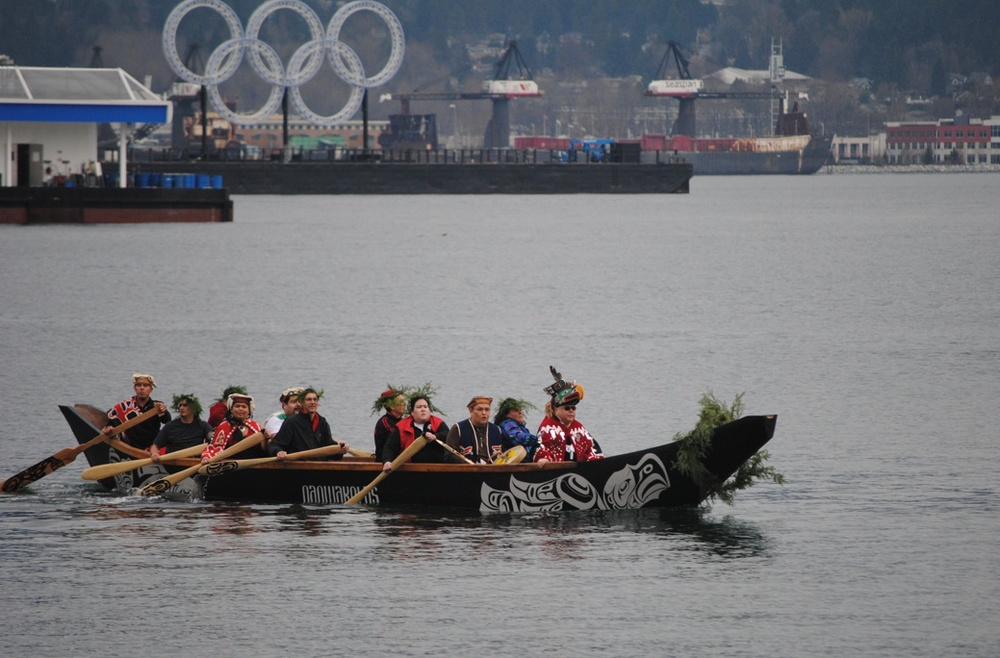 (paddling across Coal Harbour in Vancouver with the Olympic rings in the background)