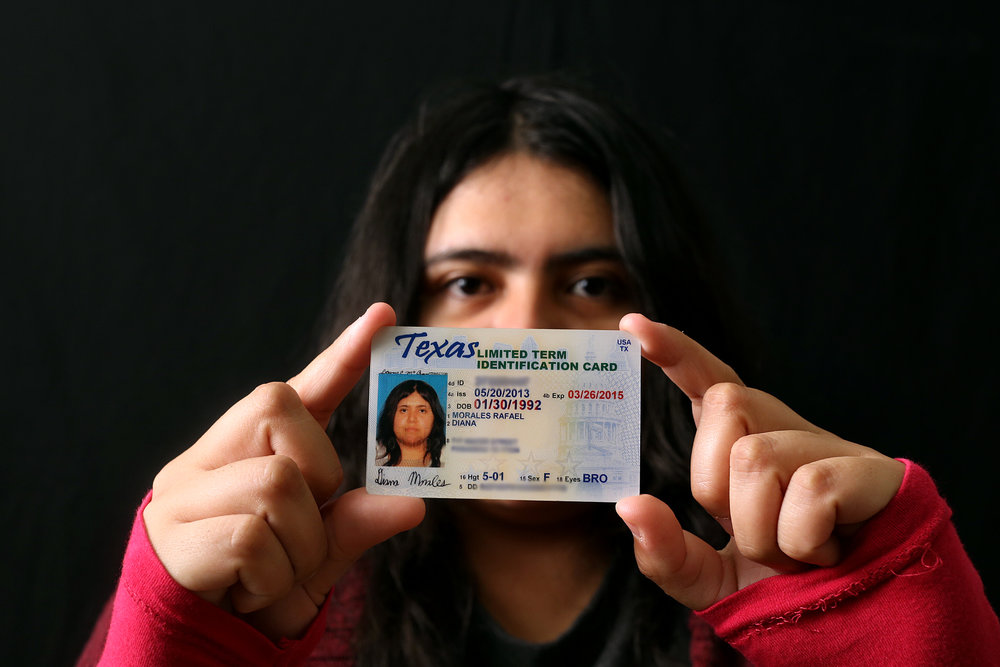 Diana Morales, sophomore at University of Texas at Austin, holds the state identification card she received through the federal deferred action program. She is one of 72,400 undocumented immigrants in Texas who have won temporary legal status through the program.