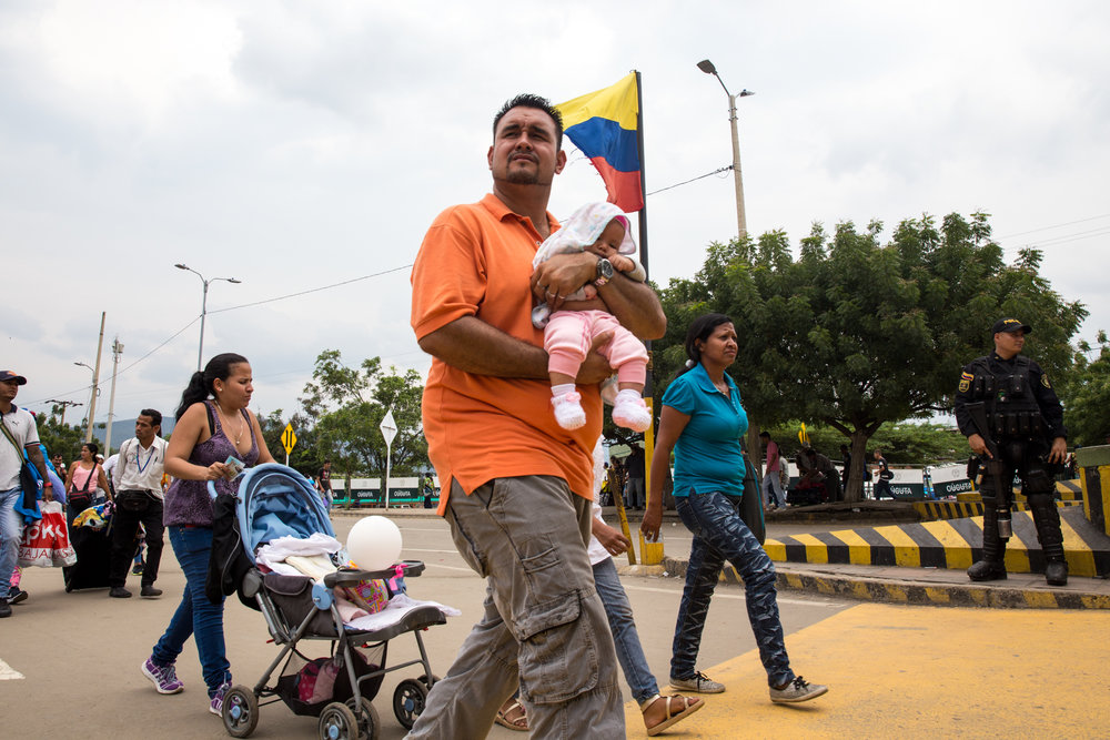 A family crosses into Colombia from Venezuela at the Simon Bolivar international bridge in Cúcuta on April 4, 2018