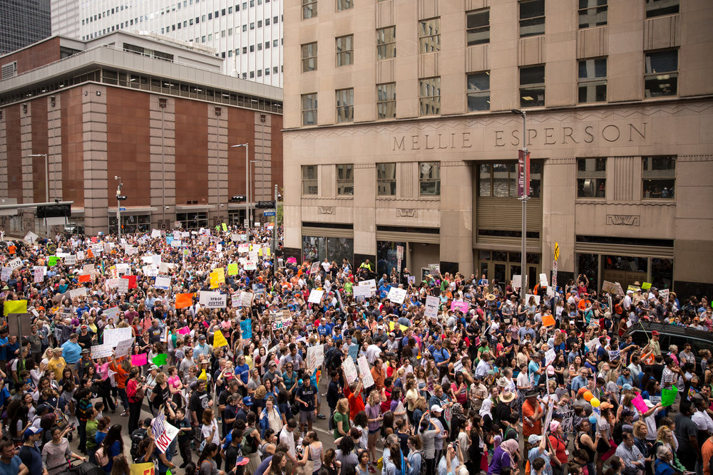A large crowd moves through downtown for the March For Our Lives rally in Houston, Texas on March 24, 2018.