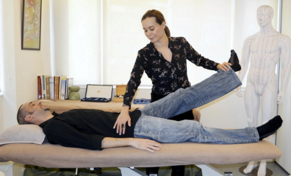 Practitioner Helen Griffiths testing the response of the psoas muscle