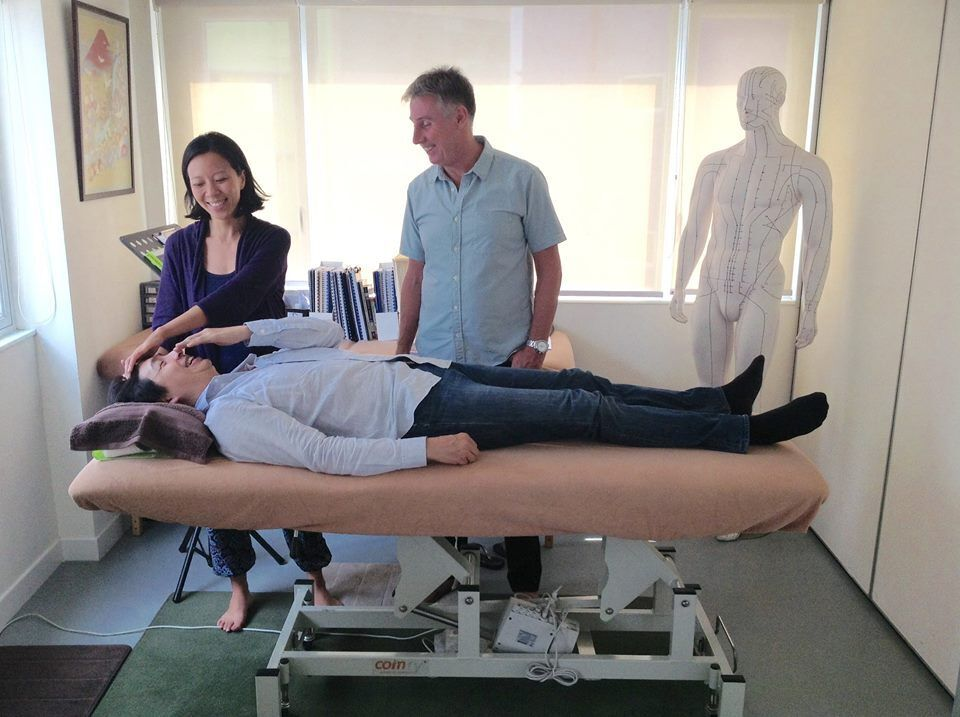 Kinesiologists Brett Scott and Joy Li in action at Kinesiology Asia.