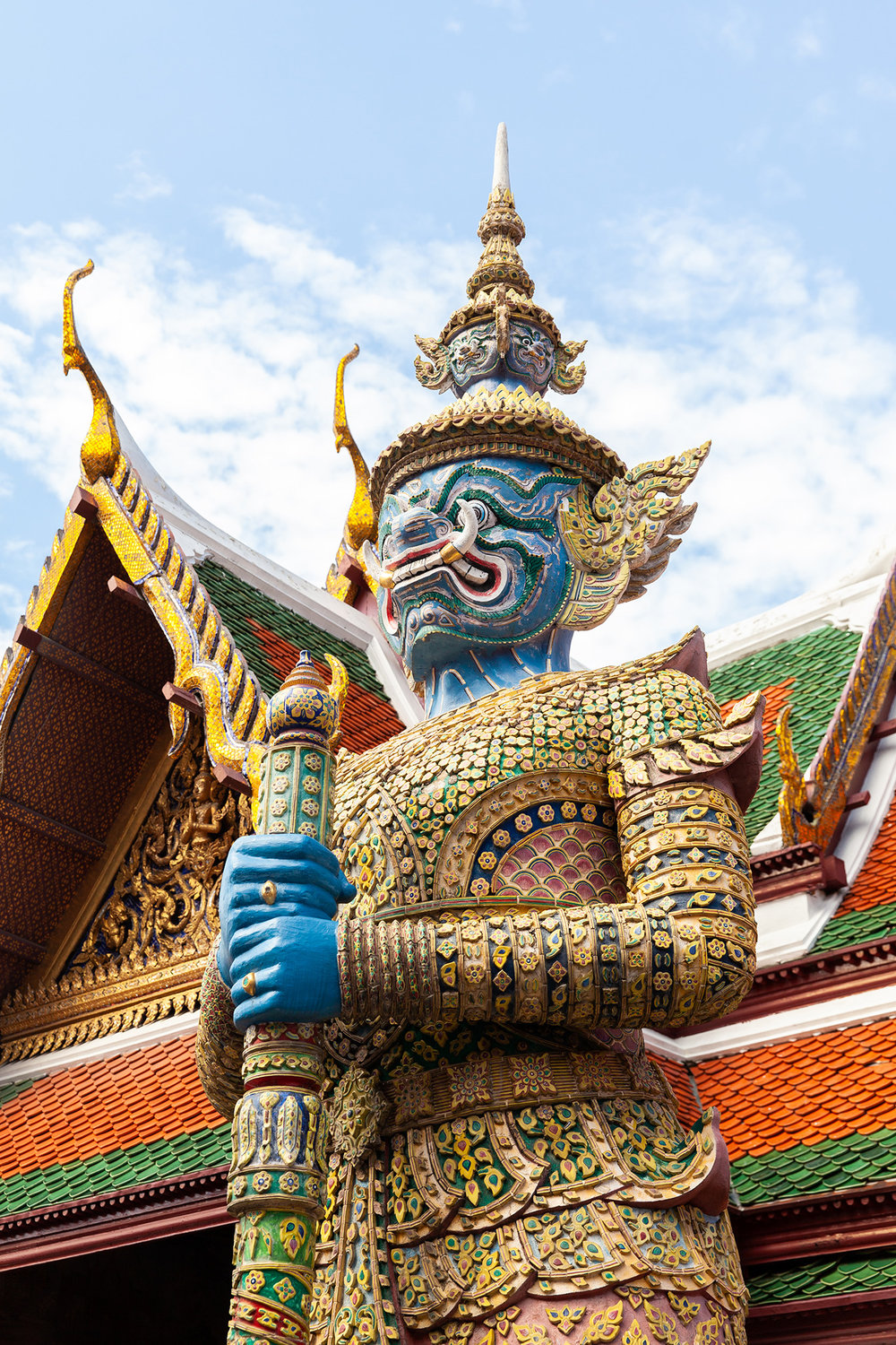 A Demon Guardian stands watch, protecting the Emerald Buddha from evil spirits, inside the Grand Palace