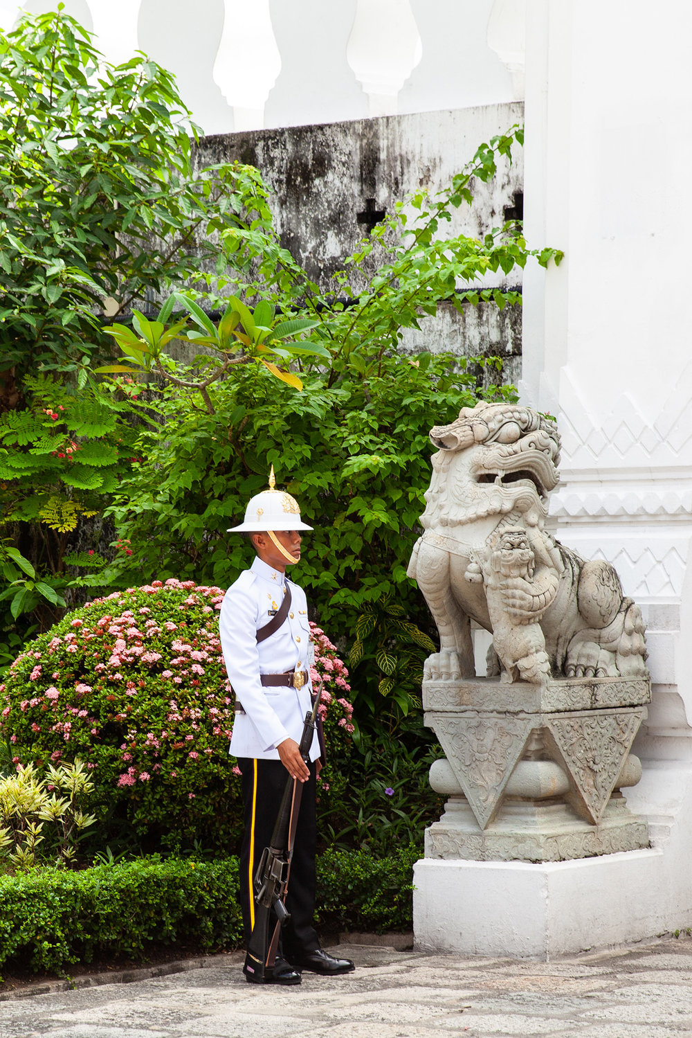 A guard keep watch inside the Grand Palace