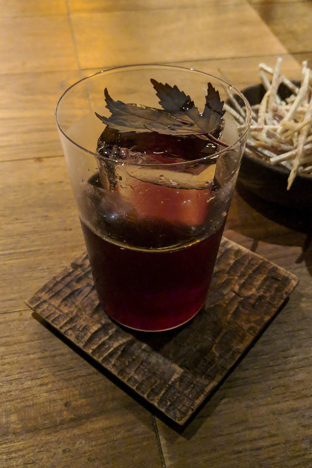 "The ""Tanuki"" cocktail at Thaipioka: Campari, Kyoho Sake, Shisho-infused Bulldog Gin"