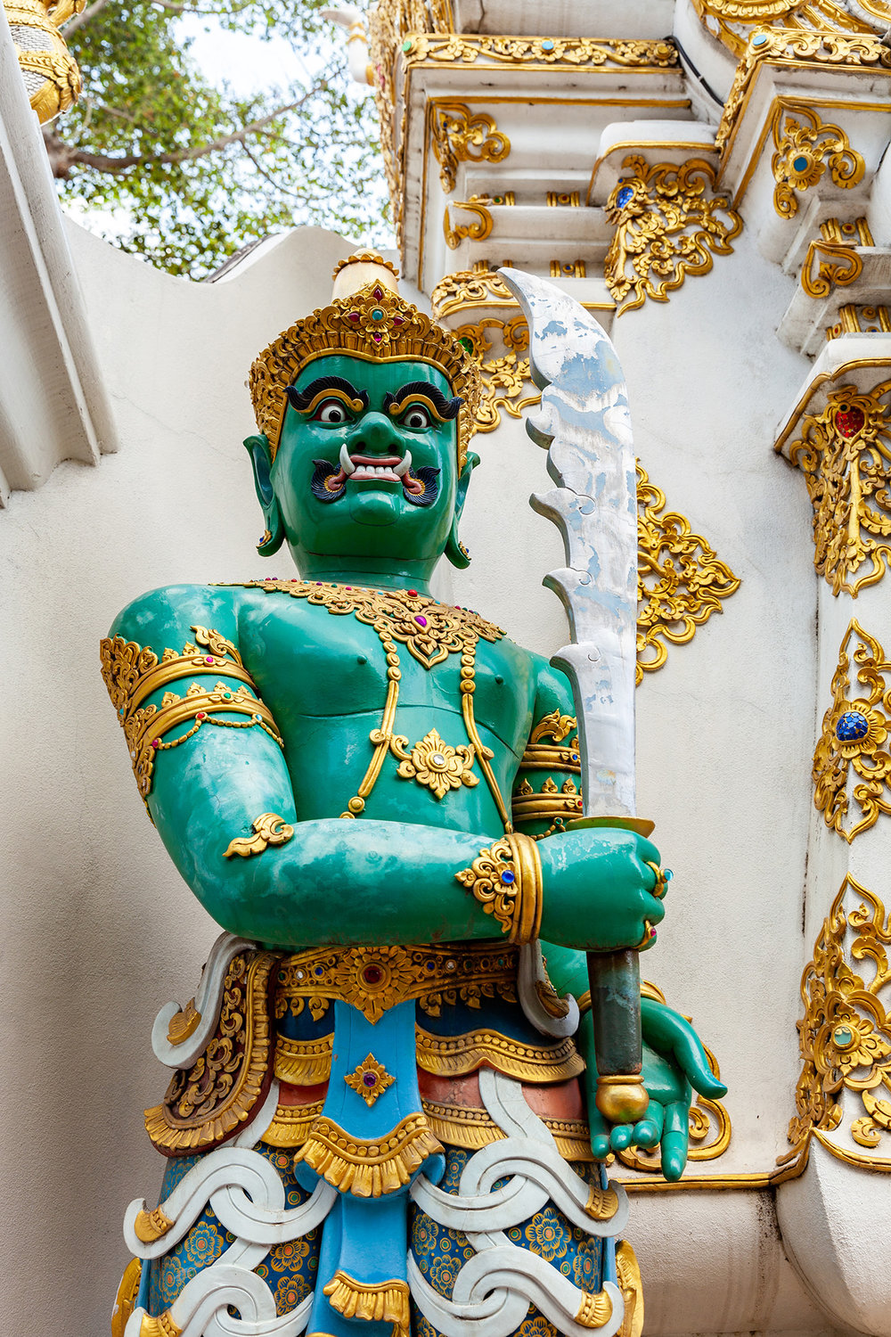 an emerald guard at Wat Chedi Luang