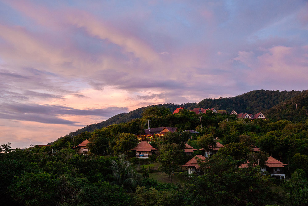 Sunset view of the Kantiang View Resort in the hills behind the Houben Hotel