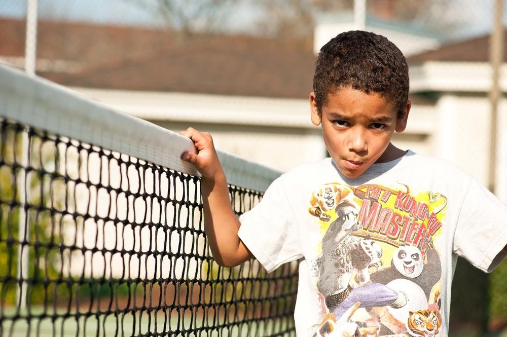 Joshua at the tennis court...