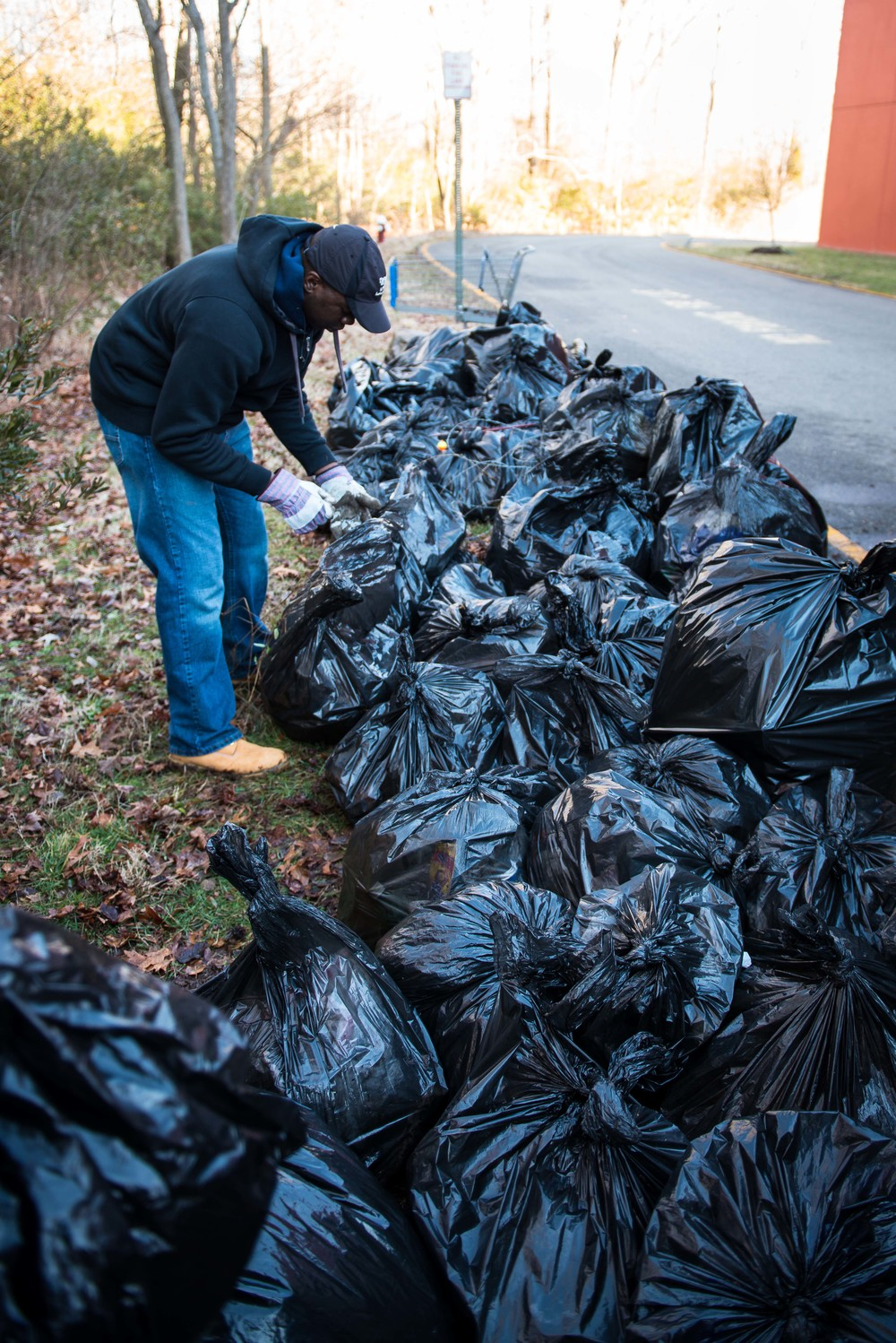 AT1 Hunter gather pounds of trash bag filled by what sailor found in the park.