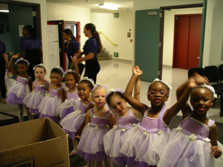 With help from older dancers and staff, young dancers prepare to perform.