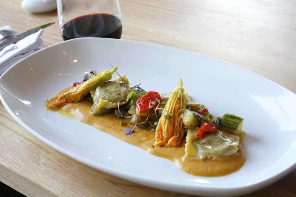Table: Escargot ravioli with a ratatouille of zuchinni, tomato, red pepper, eggplant, purple basil and ricotta-stuffed squash blossoms with saffron.