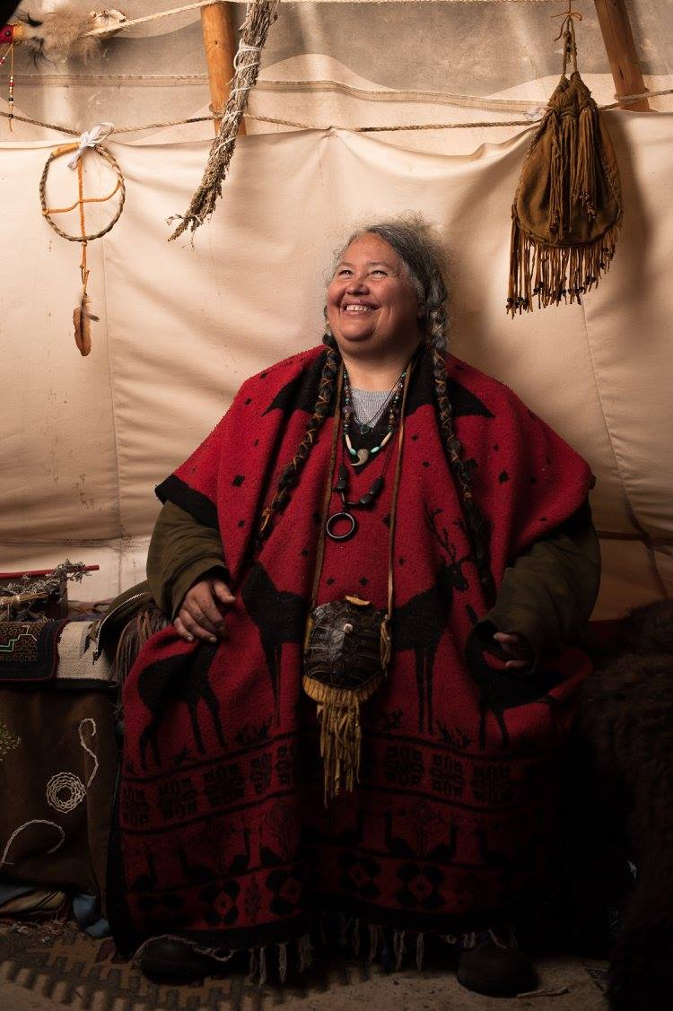 Daphne Singingtree, a Traditional Healer & Midwife, at Standing Rock, photo by Jade Beall