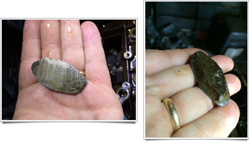 A chunk of aluminum that was found lying in the bottom of the engine.  It appears to have come from the block itself.