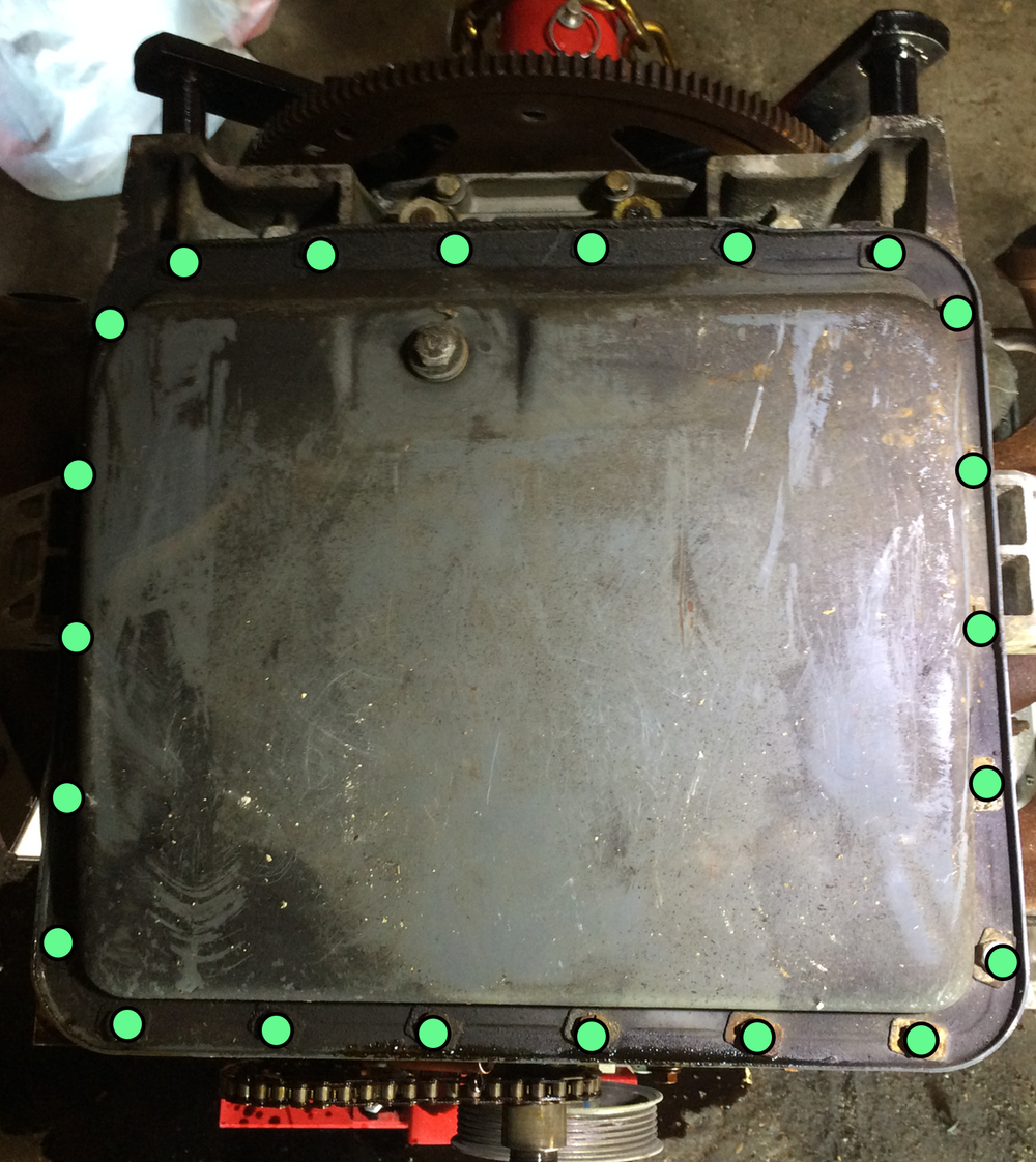 An 11mm socket can be used to remove the twenty two (22) bolts (green dots) holding the oil pan to the lower crankcase.