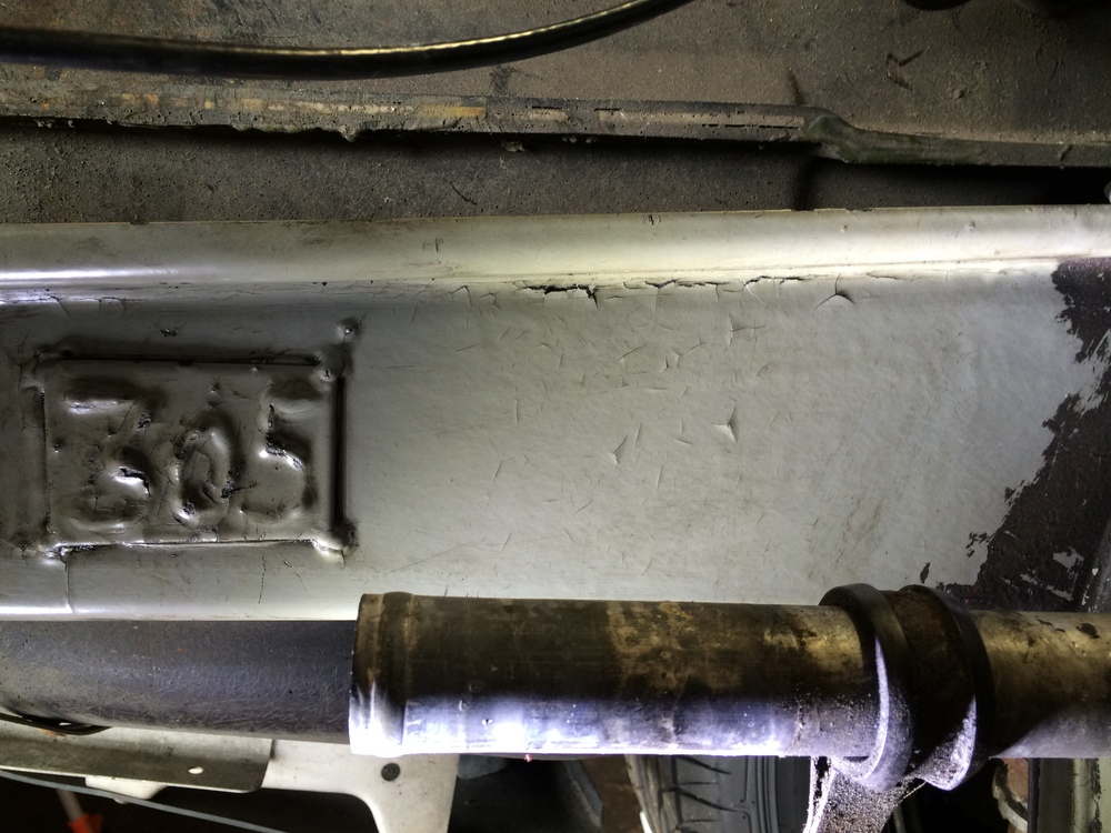 There was so much oil caked onto the frame that i didn't even know this 305 plate was there until I cleaned it off.  The remaining black on the right is undercoating.