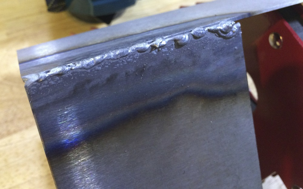 My first weld.  The bead isn't very good, and the weld was not strong, but at least it worked.