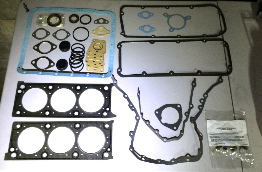The DPI 3.0L gasket set.  The large blue one is DPI's oil pan gasket.