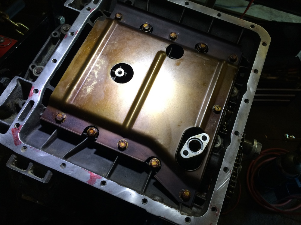 The oil baffle re-installed in the 3.0L engine.