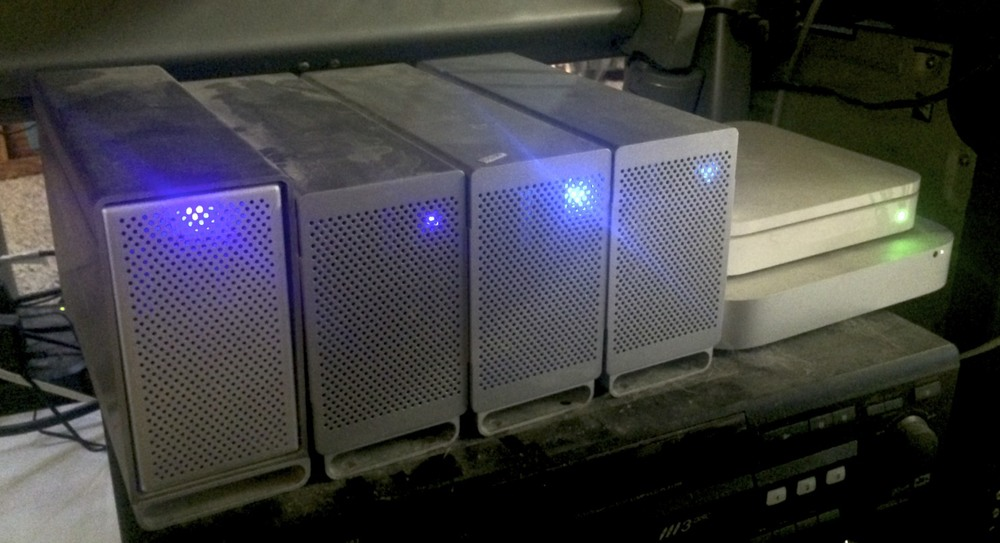 Mac mini, Airport Extreme and four drive enclosures configured as mirrored RAIDs.