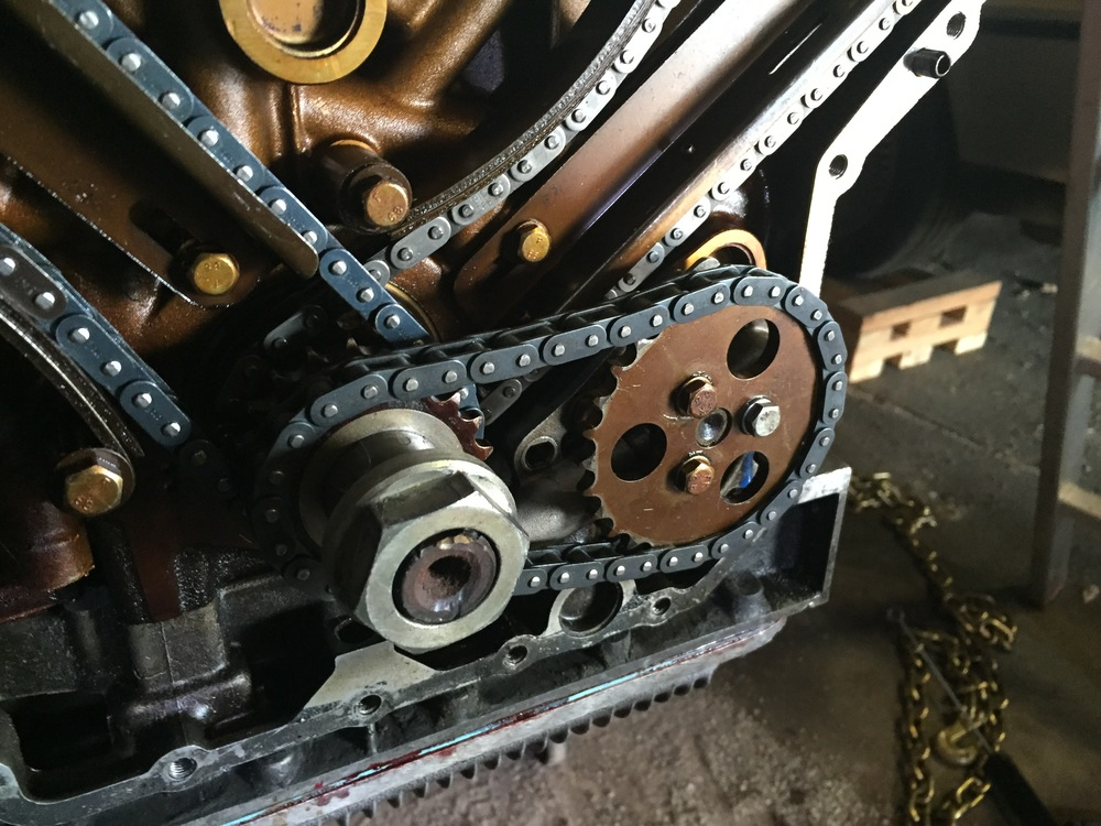 The oil pump, chain and sprocket reinstalled in the engine